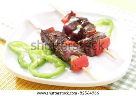 Delicious liver on stick with vegetables