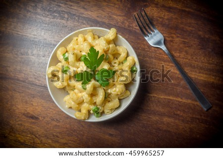 Delicious macaroni and cheddar cheese with parsley sprig
