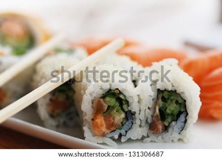 Delicious maki sushi with salmon, avocado and shrimps