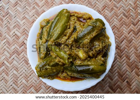 Delicious Malai Parwal curry home cooked whole pointed gourd curry with gravy served in a bowl. Parval side dish Indian curries Photo stock ©