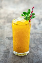 Delicious mango tropical drink with mint garnish