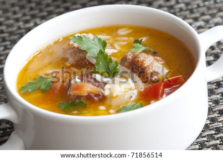 Delicious meatball and rice soup in a bowl