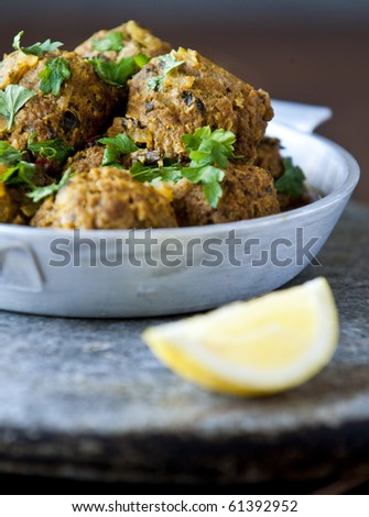 Delicious meatballs with herbs in natural light with shallow dof