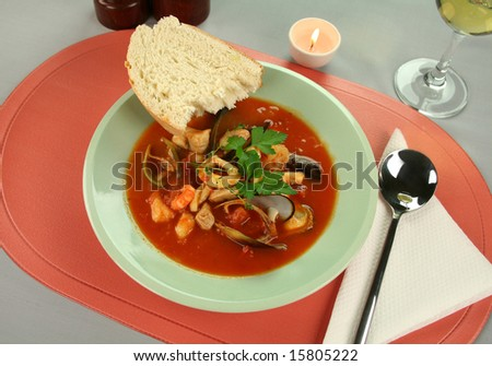 ... style tomato seafood soup with a variety of mixed seafood