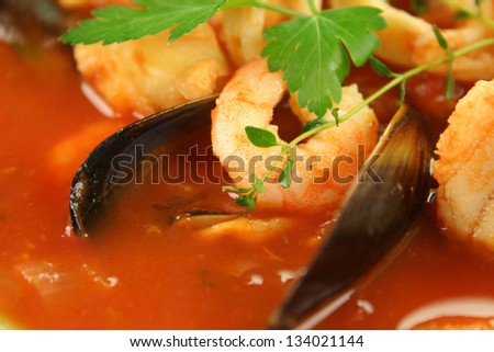 Delicious Mediterranean style tomato seafood soup with mussels and mixed seafood.