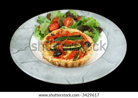 Delicious Mediterranean style vegetable and ricotta tart with salad.
