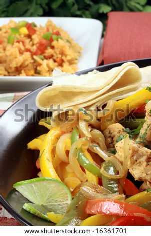 Delicious mexican fiesta plate made with fresh organic chicken and bell peppers ,exquisite fajitas