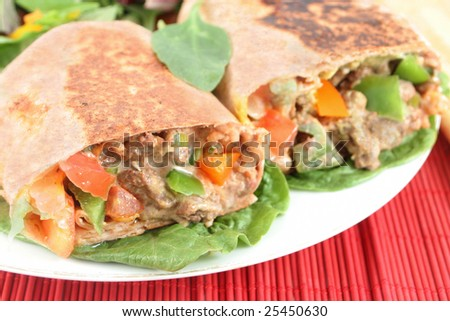 delicious mexican steak burrito with fresh vegetables
