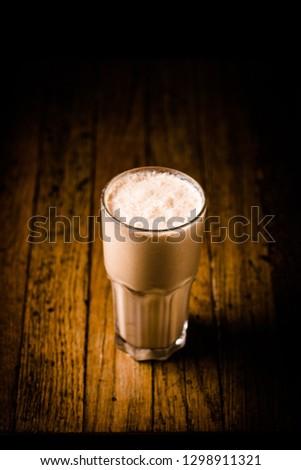 Delicious Milkshake on dark background #1298911321