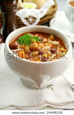 Delicious minestrone soup with fresh baked bread rolls and butter.