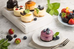 Delicious mini cheese cake decorated with fresh fruits and blueberry