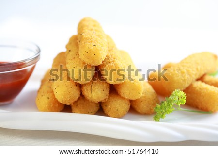 Delicious mozzarella fried sticks with tomato sauce