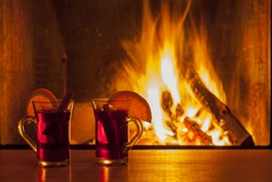 delicious mulled wine at romantic fireplace firelight only