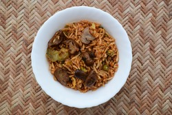 Delicious Mushroom fried rice with babycorns and other vegetables. Indian food cuisine like Mushroom biryani or pulav served in white bowl