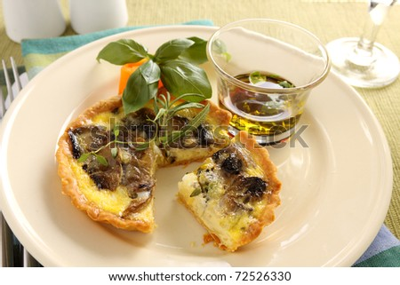 Delicious mushroom quiche with balsamic dressing.