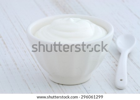 Delicious, nutritious and healthy fresh plain greek  yogurt on antique wood table