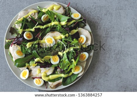 Delicious nutritious dietary salad with chicken breast and quail eggs. Keto diet. Pegan Diet. Paleo diet.