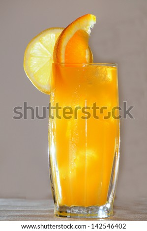 Delicious orange cocktail isolated on beige background