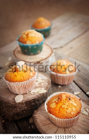 Delicious organic muffins. Almond and cherry cup cakes in natural setting.
