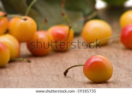 Delicious organic rainier cherries on wooden table