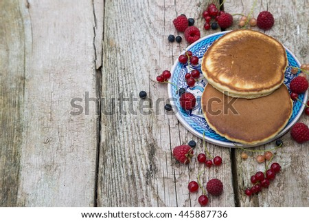 Delicious pancakes close up, with fresh berries. #445887736