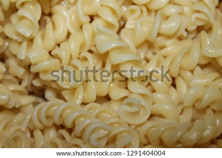 Delicious Pasta ready to be mixed with a  sauce to tingle your tastebuds. #1291404004