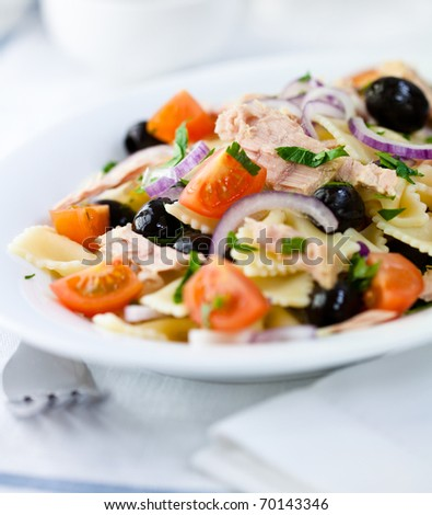 Delicious pasta salad with olives,cherry tomatoes and tuna