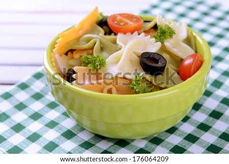Delicious pasta with tomatoes on plate on table close-up #176064209
