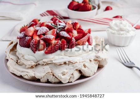 Delicious Pavlova cake dessert with fresh strawberry. White and red dessert Stock photo ©