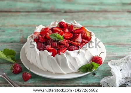 delicious Pavlova cake with fresh strawberry, seective focus Stock photo ©