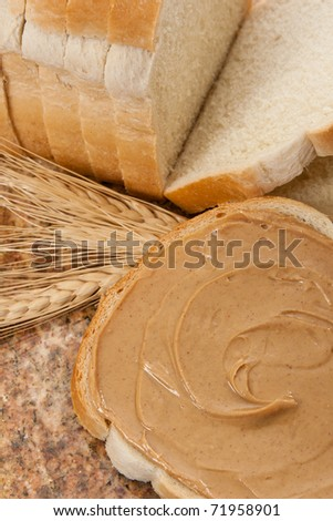 Delicious peanut butter demonstrates  a healthy snack and food allergen