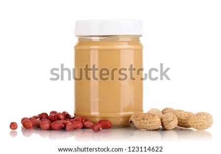 Delicious peanut butter in jar of peanut near isolated on white