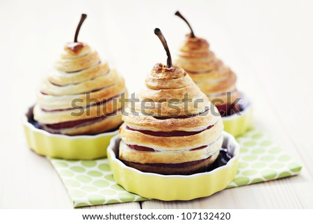 delicious pear in french pastry with red wine - sweet food #107132420