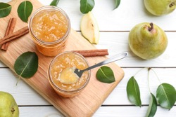 Delicious pear jam and fresh fruits on white wooden table, flat lay
