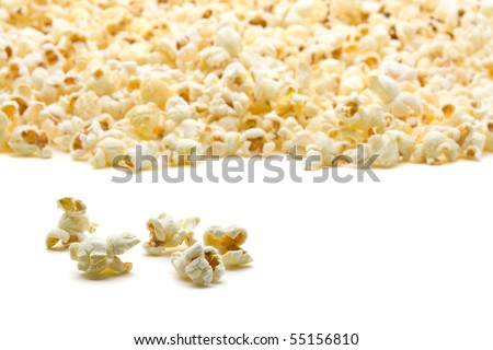 Delicious popcorn close up with shallow depth of field over white background