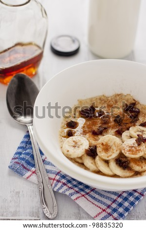 delicious porridge with banana, dates, cinnamon and maple syrup