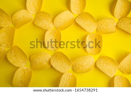 Delicious potato chips on yellow background, Junk food, fast snack, crisps