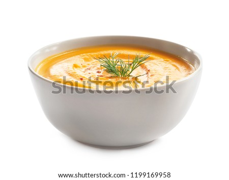Delicious pumpkin cream soup in bowl on white background