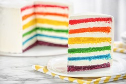 Delicious rainbow cake for party on table