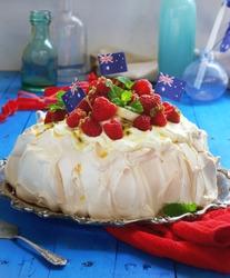 Delicious Raspberry, Banana and Passion fruit Pavlova for Australia Day. Selective Focus.