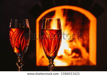 delicious red wine at romantic fireplace. Romantic concept.