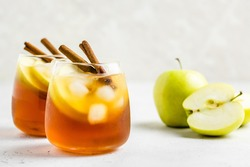 Delicious refreshing summer apple cinnamon iced tea in glasses. Space ofr text.