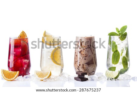delicious refreshing summer drinks . Sangria , lemonade, iced chocolate drink , a mojito on a white background . Ice cubes around glasses with drinks . Natural collage of beverages #287675237