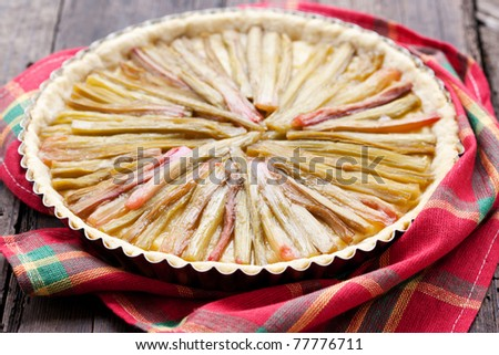 Delicious rhubarb pie on rustic background
