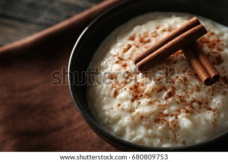 Delicious rice pudding with cinnamon in bowl, closeup Stock photo ©
