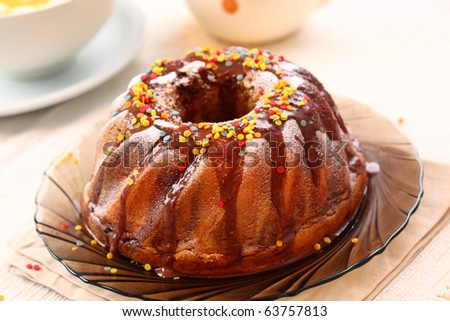 Delicious ring cake garnished with hot chocolate - stock photo