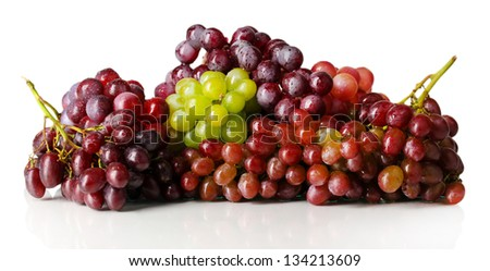 Delicious ripe grapes isolated on white