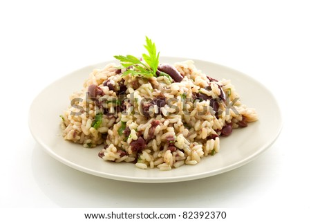 delicious risotto with black olives on white isolated background