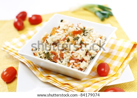 Delicious risotto with tomato and onion