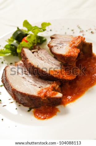 Delicious roast pork spiced with hot sauce.